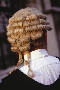 Rear view of a legal professional in his gown and wig